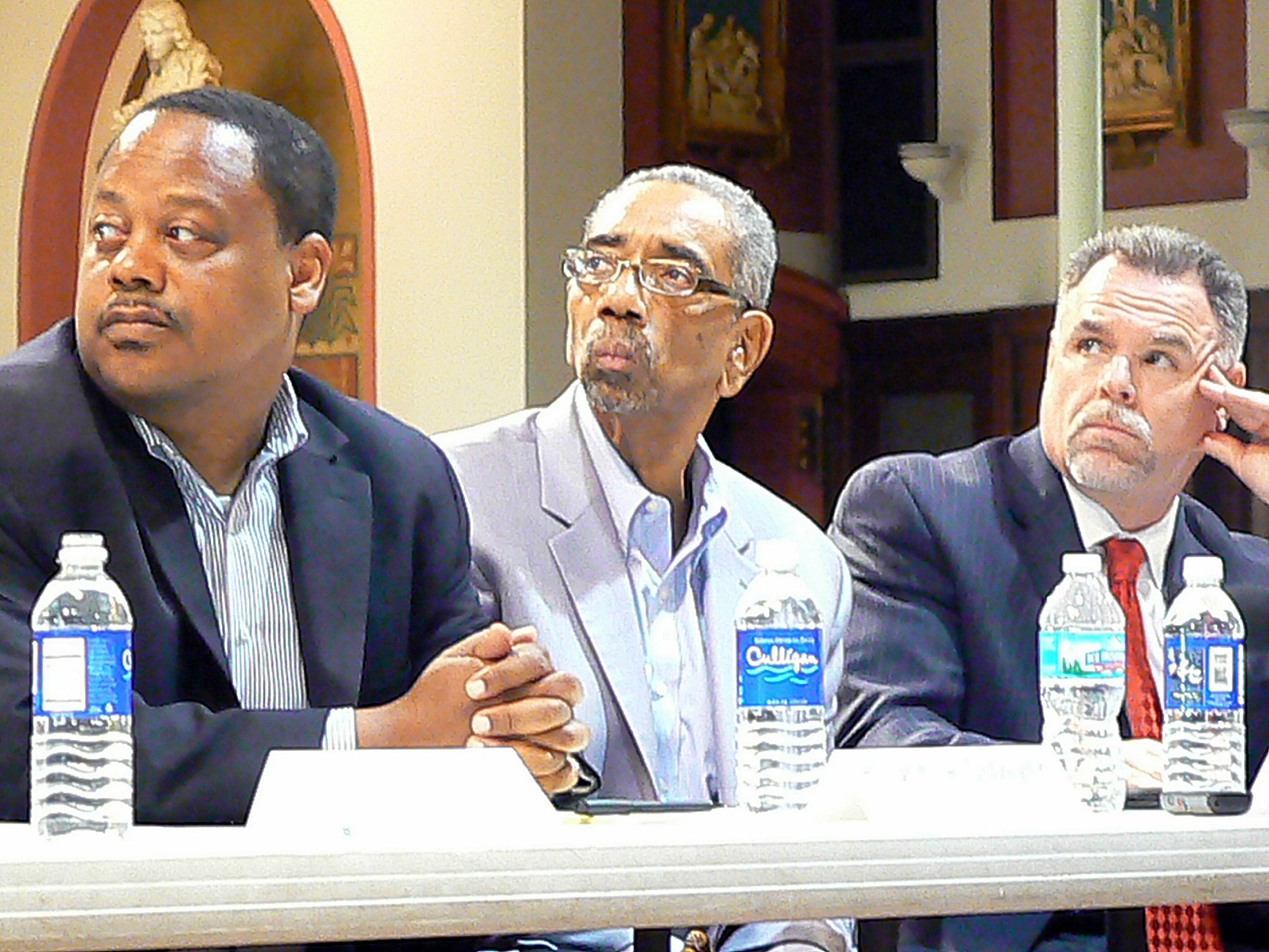 Sixth Ward Ald. Rod Sawyer, U.S. Congressman Bobby Rush, and Police Superindent Garry McCarthy listen to remarks from other law enforcement officials about reducing crime in Chatham.