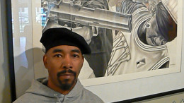 Artist James Pate stands in front of his drawing entitled Kin Killin Kin which is on display at DuSable Museum of African-American History.