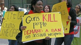 Marchers protest outside federal plaza in Chicago to demand tougher gun control legislation.