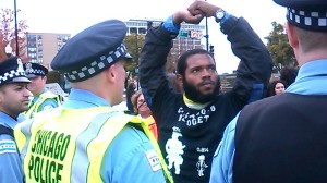A protester face offs with police during a demonstration against the International Association of Chiefs of Police conference held last October in Chicago.